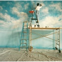 'Duane's Sky' is a 20x50' backdrop created for renowned photographer Duane Rieder in his Pittsburgh studio. This airy effect was commissioned for a United Airlines print campaign, and was painted directly onto a cyclorama wall. It has subsequently been utilized in many other photo shoots. That's Jennifer with her head in the clouds.