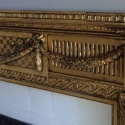 A fireplace mantle at the magnificent Hoffstott mansion on Fifth Ave. in Pittsburgh was in need of TLC. Here are before-and-after shots of the mantle piece gilded and glazed to maintain it's distinguished, aged looked.